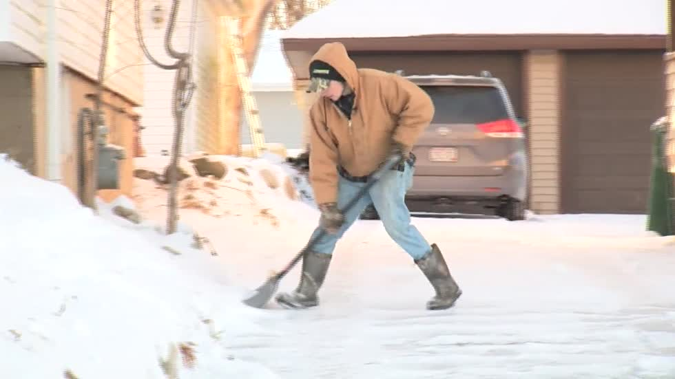 Hartford teen shovels driveways for free